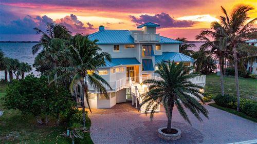 Photo of 7667 Pelican Pointe Drive, Jensen Beach, FL 34957 (MLS # RX-10715593)