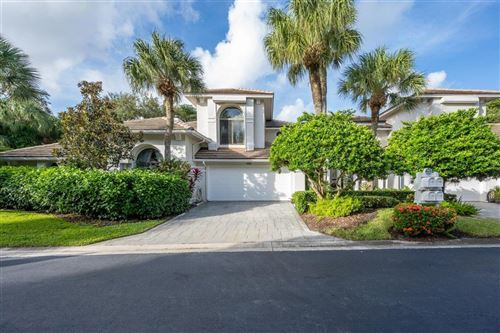 Photo of 463 Coral Cove Drive, Juno Beach, FL 33408 (MLS # RX-10669601)