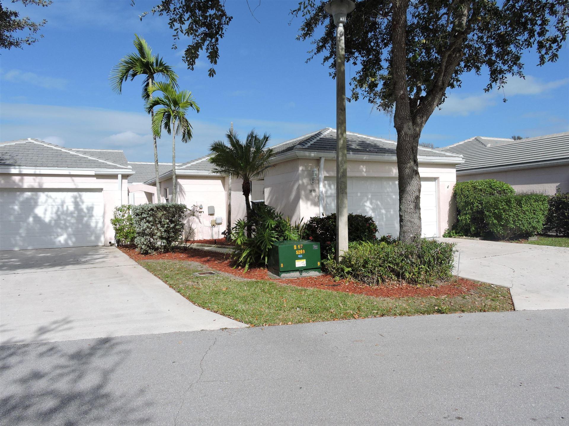 Photo of 1037 Island Manor Drive Drive, Greenacres, FL 33413 (MLS # RX-10681601)