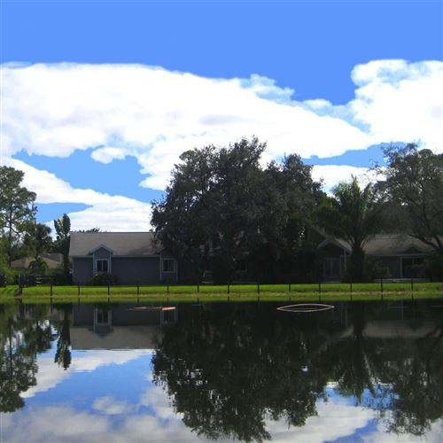 Photo of 12876 154th Road N, Jupiter, FL 33478 (MLS # RX-10595604)