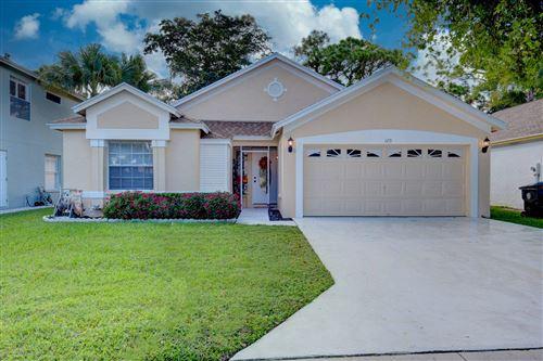 Photo of 120 Paddock Lane, Greenacres, FL 33413 (MLS # RX-10753605)