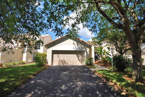 Photo of 3828 Wilderness Way, Coral Springs, FL 33065 (MLS # RX-10612608)