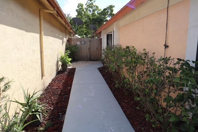 Photo of 915 E Maple Street, North Lauderdale, FL 33068 (MLS # RX-10751608)