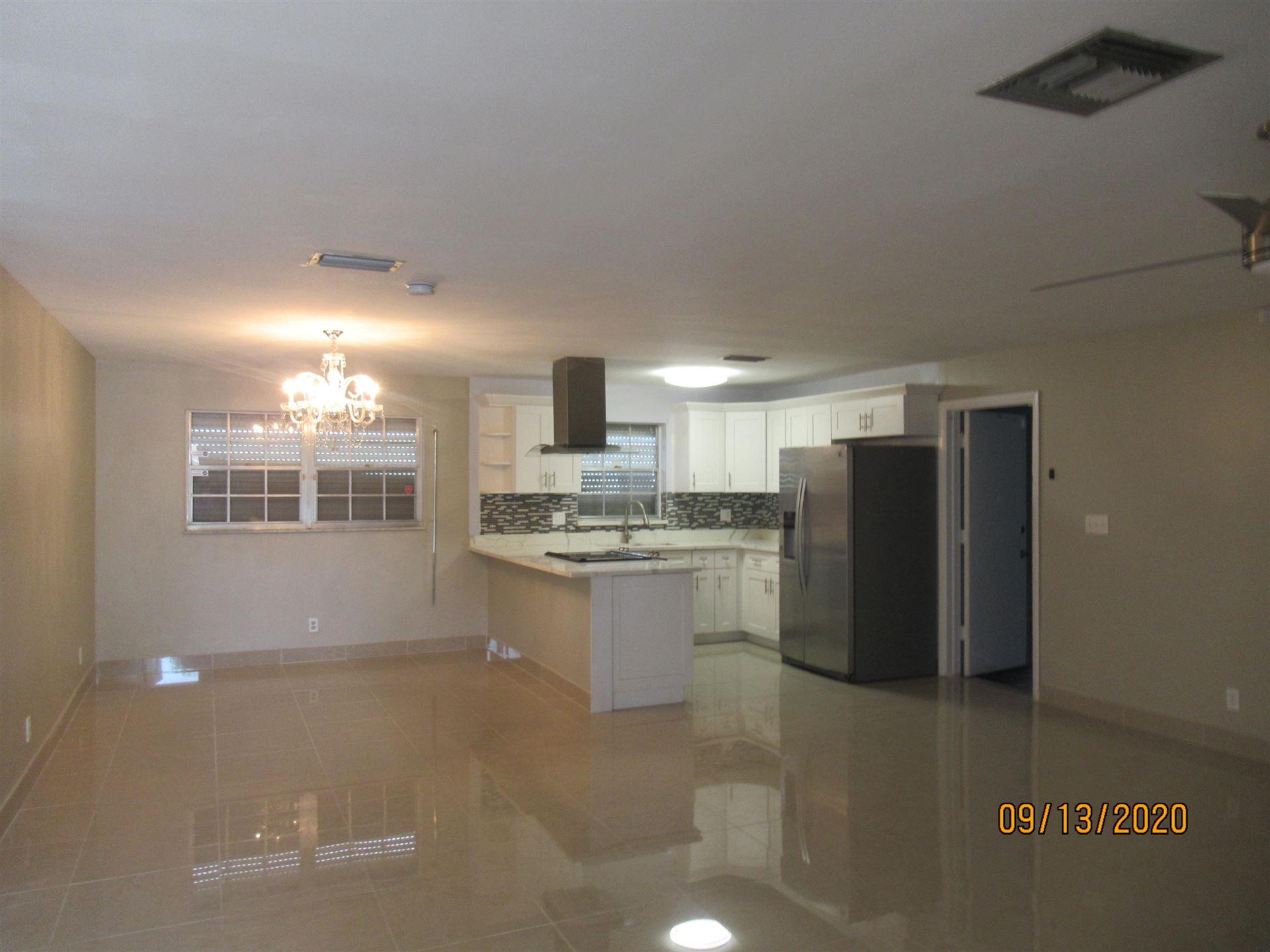 Photo of 1585 Ac Evans Street, Riviera Beach, FL 33404 (MLS # RX-10654609)