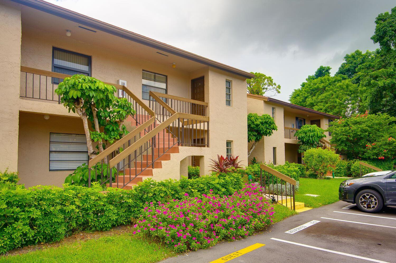 Photo of 21211 Lago Circle #D, Boca Raton, FL 33433 (MLS # RX-10723616)