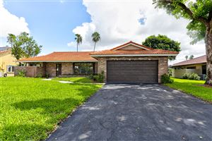 Photo of 8697 NW 1st Street, Coral Springs, FL 33071 (MLS # RX-10560617)