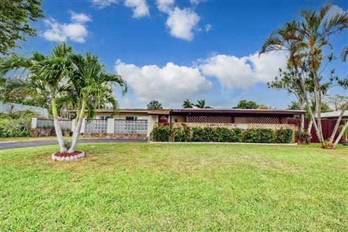 Photo of 965 Orchid Drive, Royal Palm Beach, FL 33411 (MLS # RX-10714634)