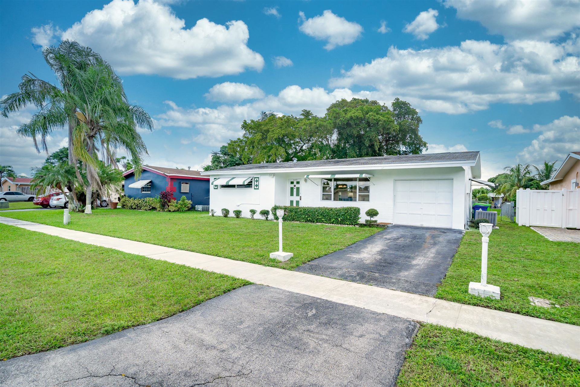 Photo of 8640 NW 27th Place, Sunrise, FL 33322 (MLS # RX-10752634)