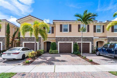 Photo of 5098 Ashley River Road, West Palm Beach, FL 33417 (MLS # RX-10745635)