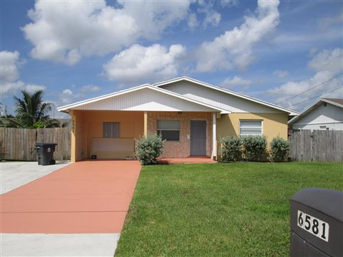 Photo of 6581 Venetian Drive, Lake Worth, FL 33462 (MLS # RX-10656638)