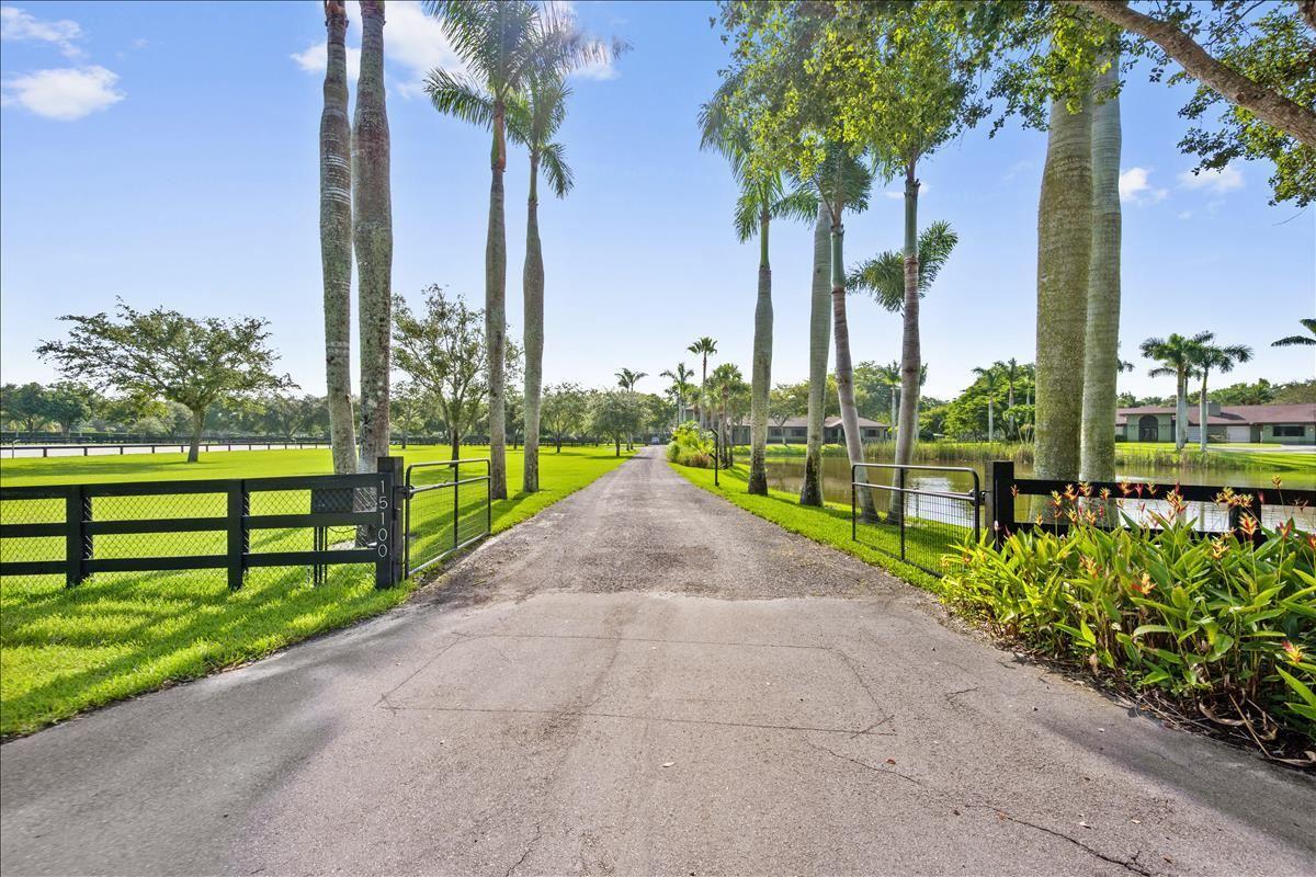 Photo of 15100 Golden Point Lane, Wellington, FL 33414 (MLS # RX-10732641)