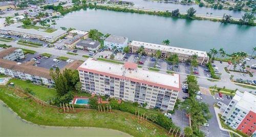 Photo of 1101 Crystal Lake Dr #205, Deerfield Beach, FL 33064 (MLS # RX-10715642)
