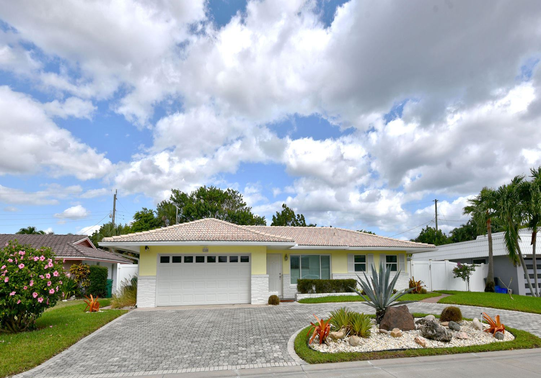 Photo of 1140 Singer Drive, Riviera Beach, FL 33404 (MLS # RX-10672645)