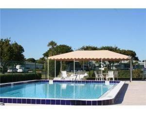 Photo of 7259 W Oakridge Circle #D, Lake Worth, FL 33462 (MLS # RX-10590651)