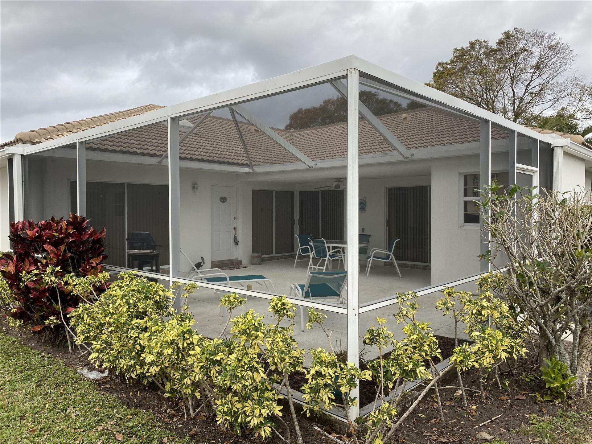 Photo of 1803 Silverleaf Oak Court, Palm Beach Gardens, FL 33410 (MLS # RX-10685651)