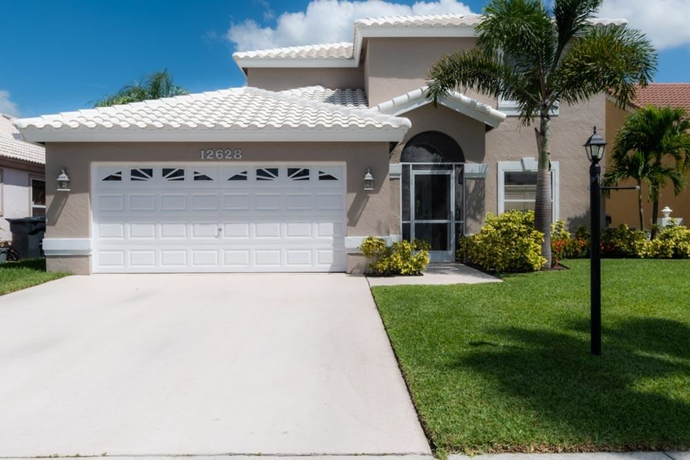 Photo of 12628 White Coral Drive, Wellington, FL 33414 (MLS # RX-10656652)