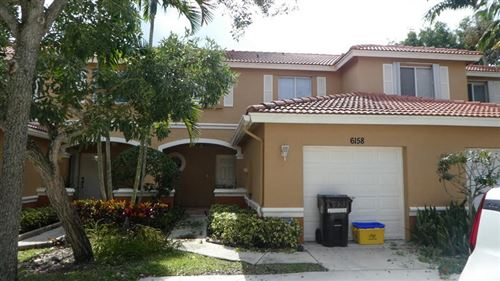 Photo of 6158 Reynolds Street, West Palm Beach, FL 33411 (MLS # RX-10575657)