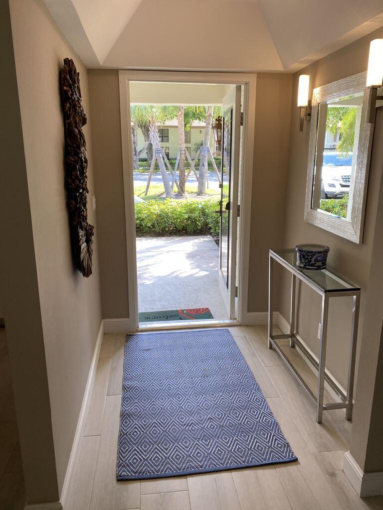 Photo of 149 Brackenwood Road, Palm Beach Gardens, FL 33418 (MLS # RX-10712658)