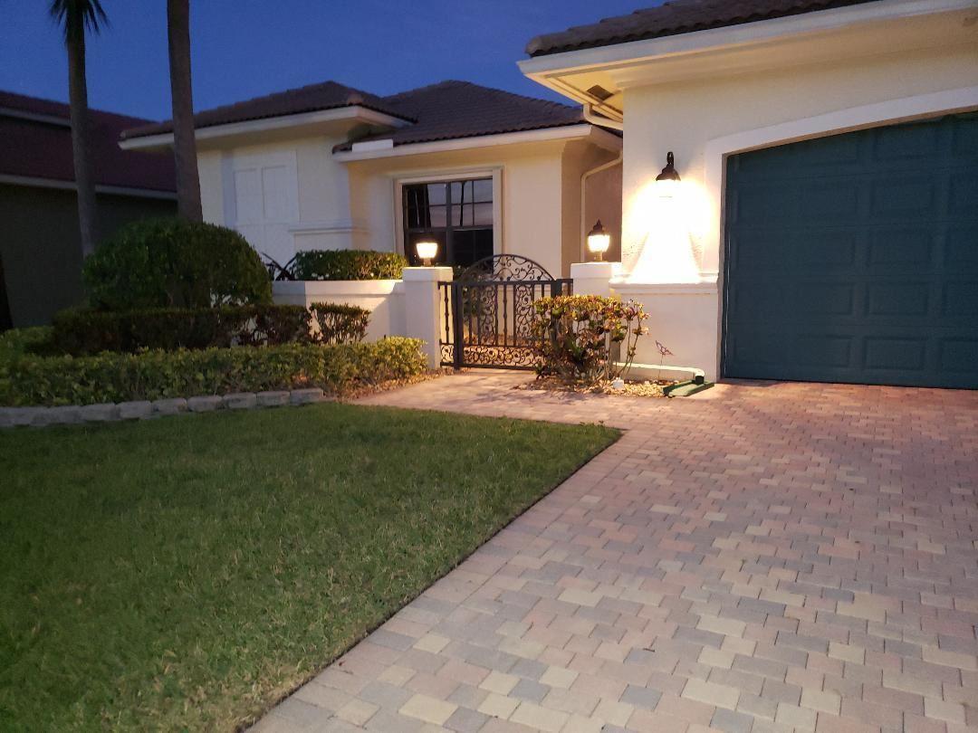Photo of 9266 Isles Cay Drive, Delray Beach, FL 33446 (MLS # RX-10609659)