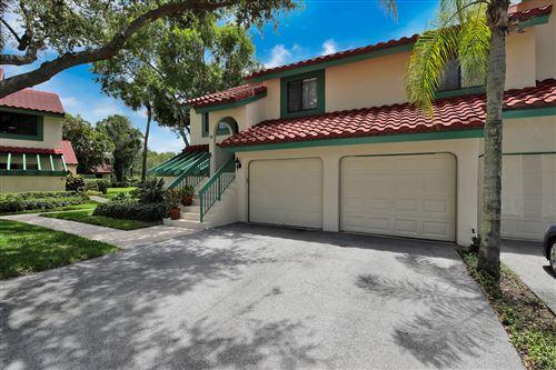 Photo of 10 Lexington Lane E #E, Palm Beach Gardens, FL 33418 (MLS # RX-10629660)