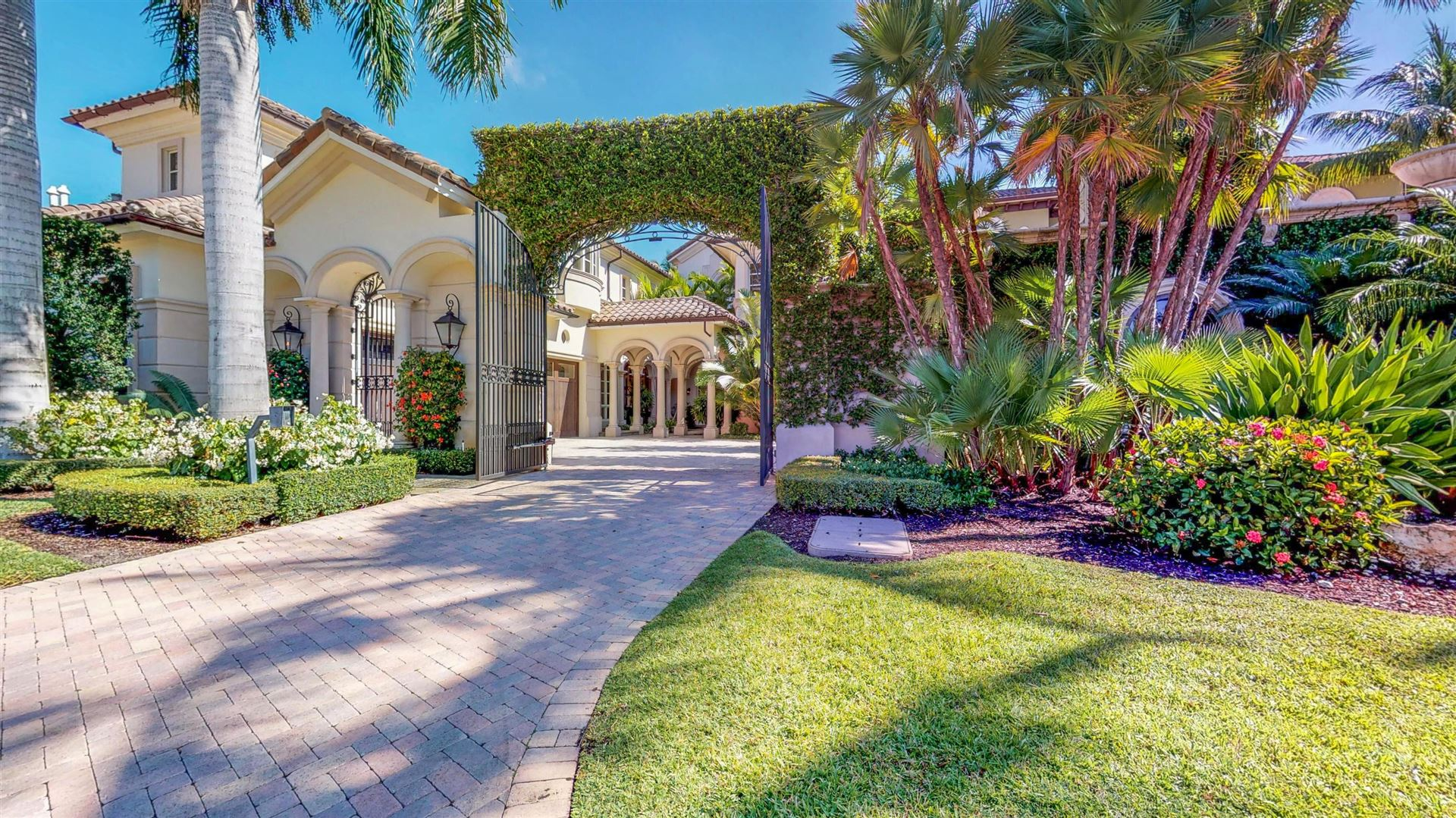 Photo of 361 SE Mizner Lake Estates Lane, Boca Raton, FL 33432 (MLS # RX-10716660)