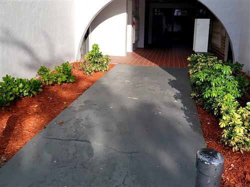Photo of 1880 N Congress Ave Avenue #G 101, West Palm Beach, FL 33401 (MLS # RX-10753661)