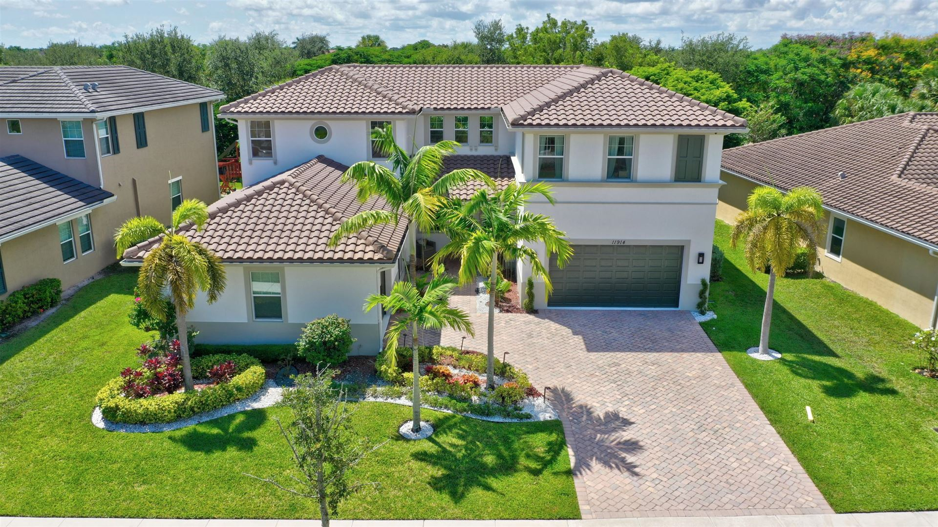 Photo of 11914 NW 79th Court, Parkland, FL 33076 (MLS # RX-10659661)