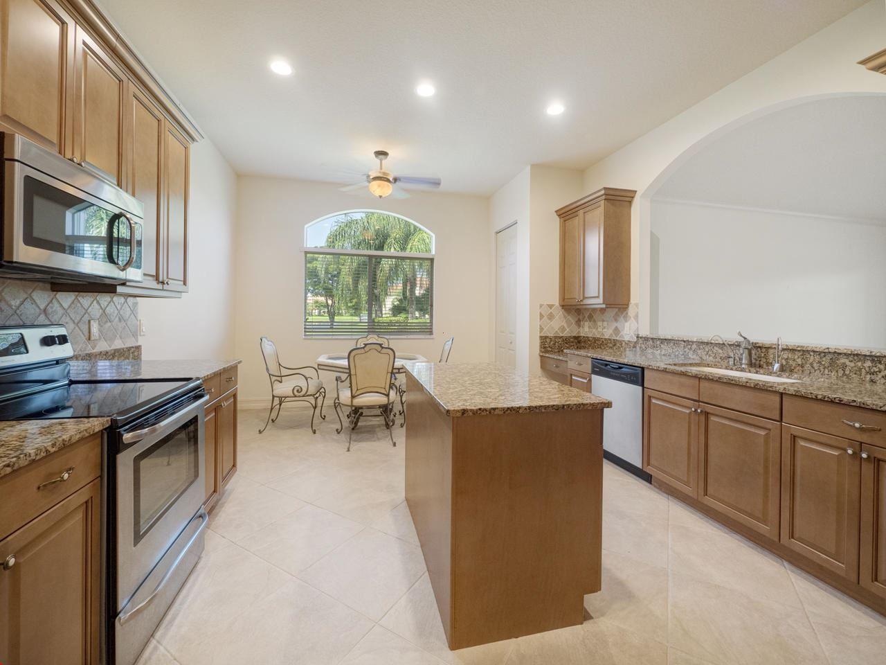 Photo of 120 Palm Bay Drive #A, Palm Beach Gardens, FL 33418 (MLS # RX-10633663)