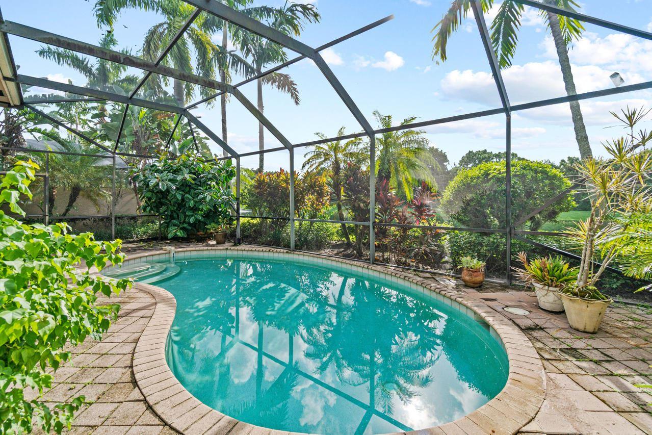 Photo of 34 Laguna Terrace, Palm Beach Gardens, FL 33418 (MLS # RX-10661668)
