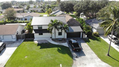 Photo of 3042 Cardinal Drive, Delray Beach, FL 33444 (MLS # RX-10656669)