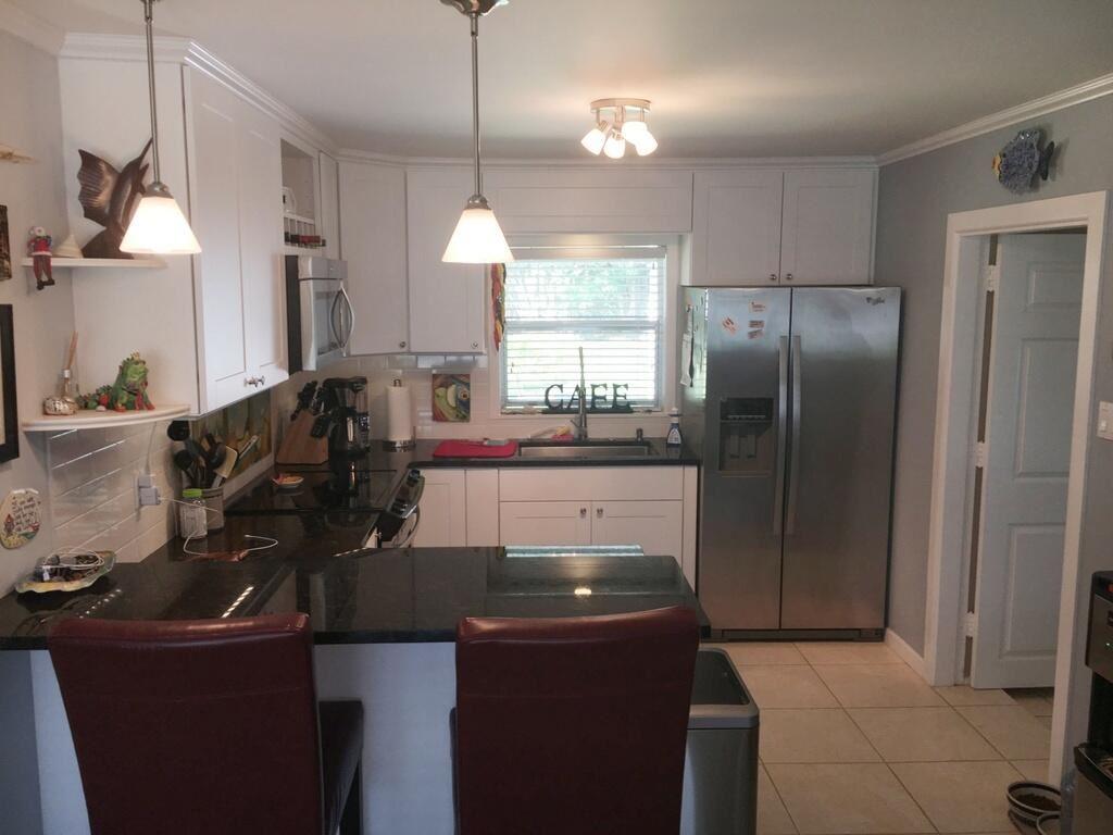5006 SE Capstan Avenue, Stuart, FL 34997 - #: RX-10708669