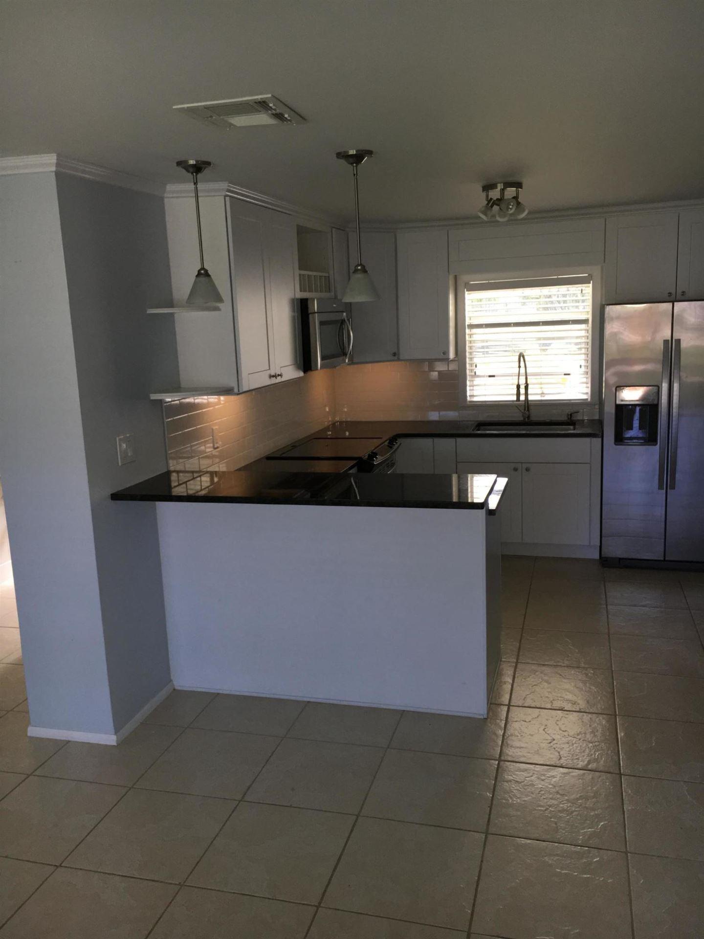 Photo of 5006 SE Capstan Avenue, Stuart, FL 34997 (MLS # RX-10708669)