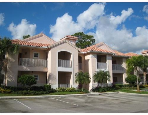 Photo of 9833 Perfect Drive #Side A, Port Saint Lucie, FL 34986 (MLS # RX-10597676)