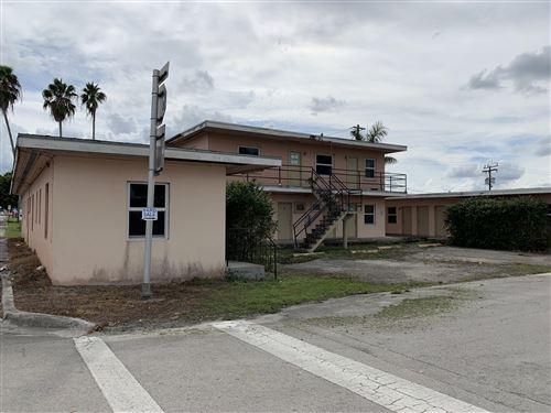 Photo of 308 N Main Street, Belle Glade, FL 33430 (MLS # RX-10751676)