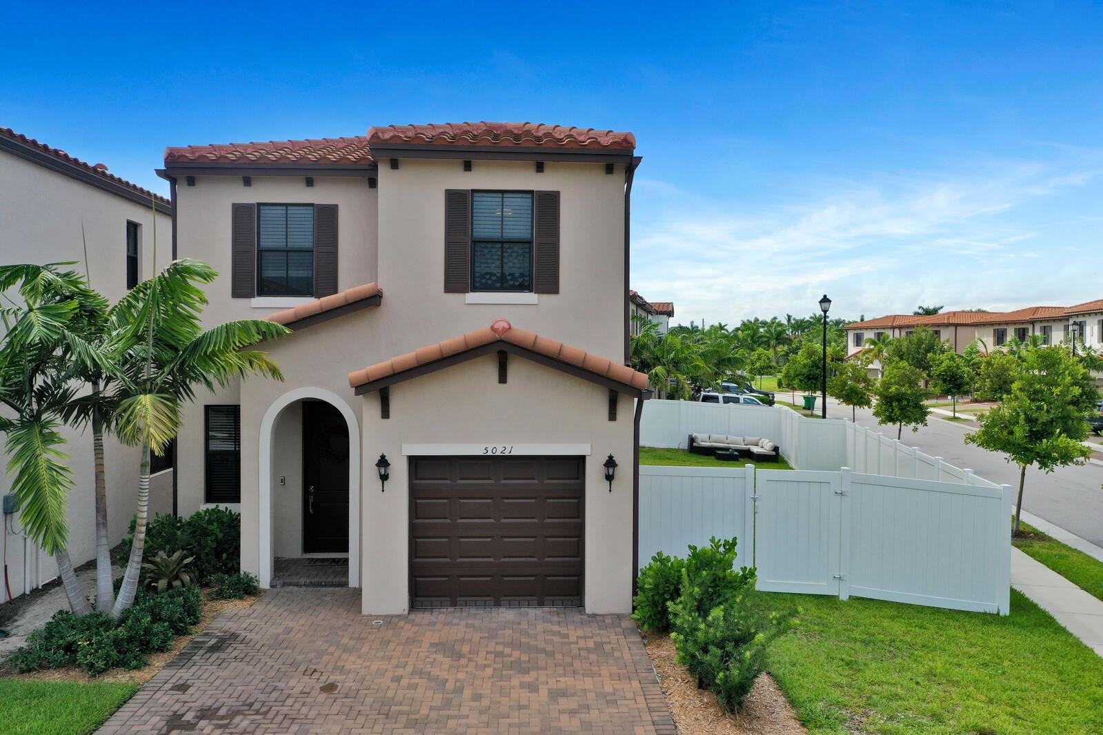 Photo of 5021 Laurel Oak Drive, Riviera Beach, FL 33410 (MLS # RX-10656678)