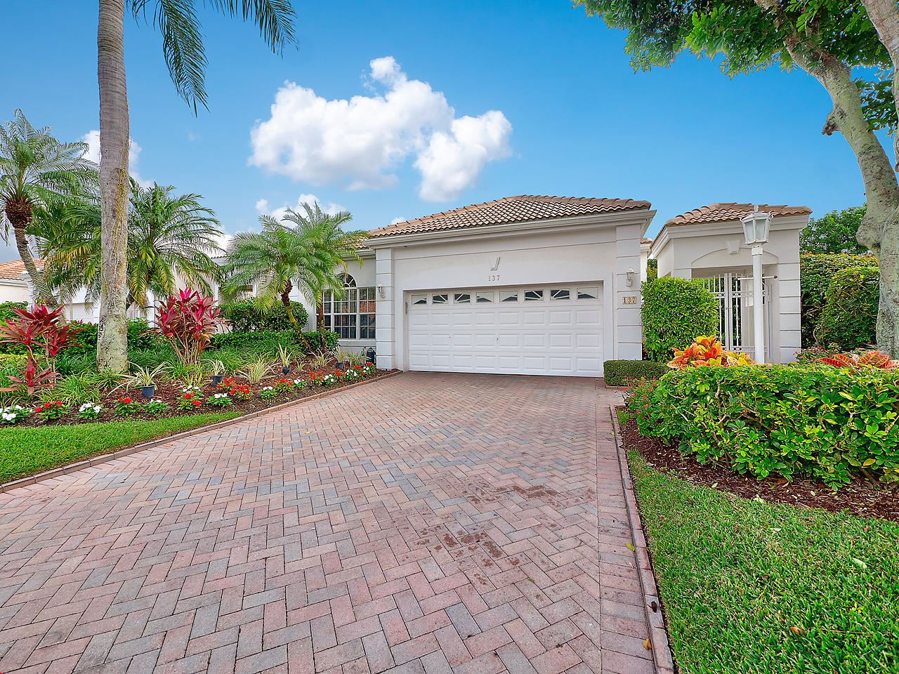 Photo of 137 Coral Cay Drive, Palm Beach Gardens, FL 33418 (MLS # RX-10678684)