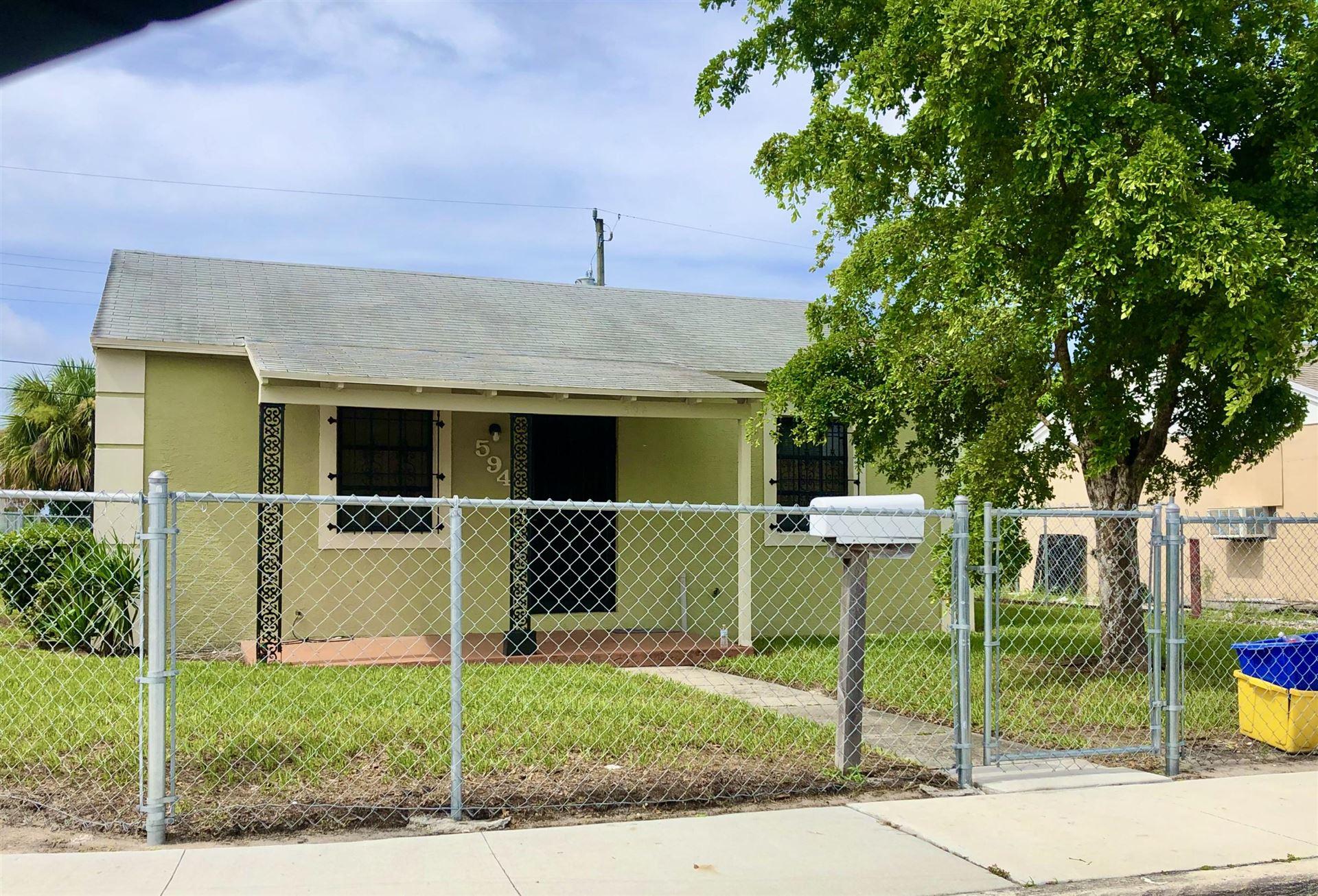 Photo of 594 W 3rd Street, Riviera Beach, FL 33404 (MLS # RX-10653685)