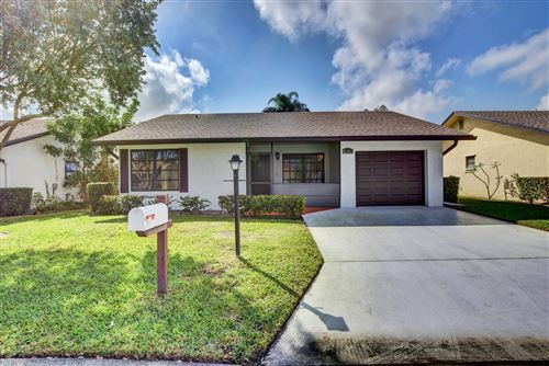 Photo of 6261 Tall Cypress Circle, Greenacres, FL 33463 (MLS # RX-10601689)