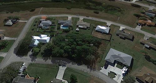 Photo of 714 SW Tupper Lane, Port Saint Lucie, FL 34953 (MLS # RX-10735689)
