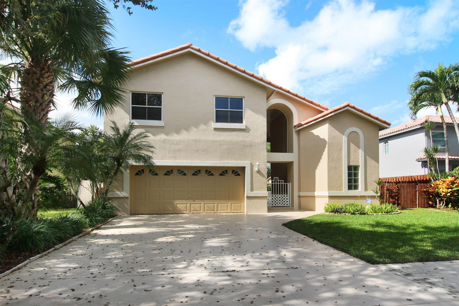Photo of 6331 NW 58th Way, Parkland, FL 33067 (MLS # RX-10664691)