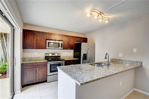Photo of 520 Green Springs Place #D, West Palm Beach, FL 33409 (MLS # RX-10614692)