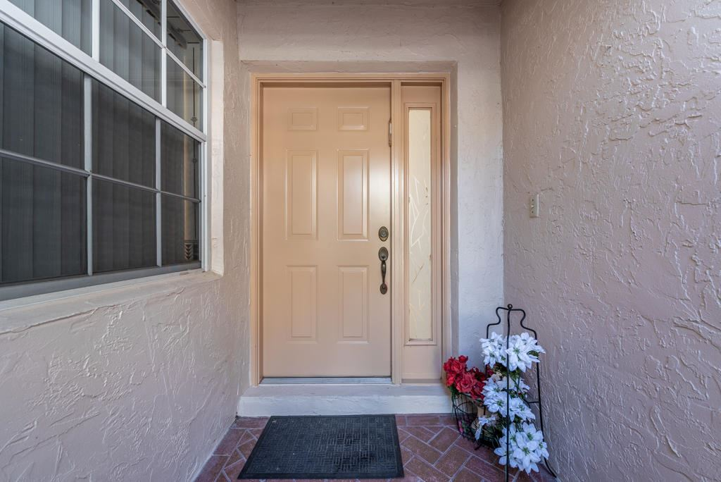 Photo of 7718 Coral Lake Drive #153, Delray Beach, FL 33446 (MLS # RX-10686692)