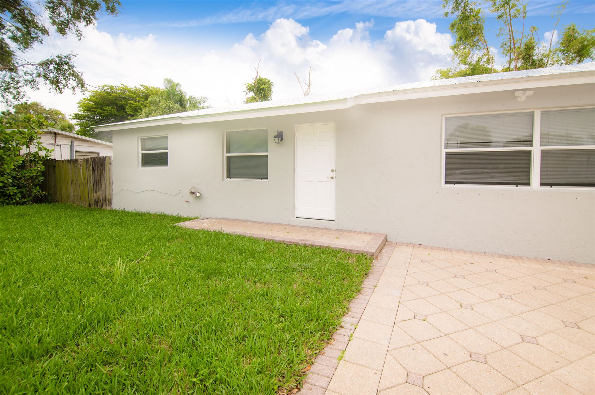 Photo of 1783 Wheeler Road, North Palm Beach, FL 33408 (MLS # RX-10725692)