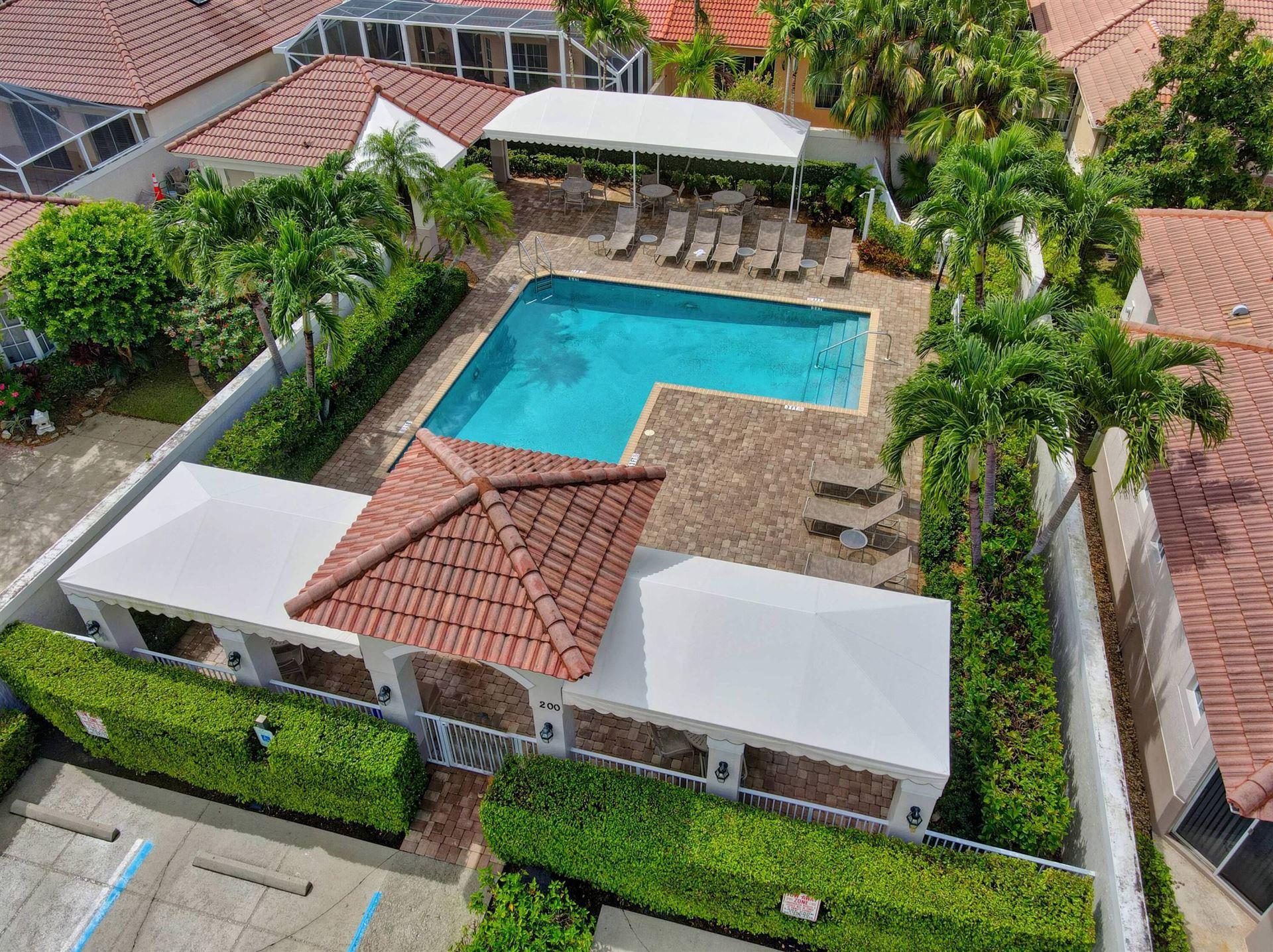 Photo of 38 Monterey Pointe Drive, Palm Beach Gardens, FL 33418 (MLS # RX-10741697)