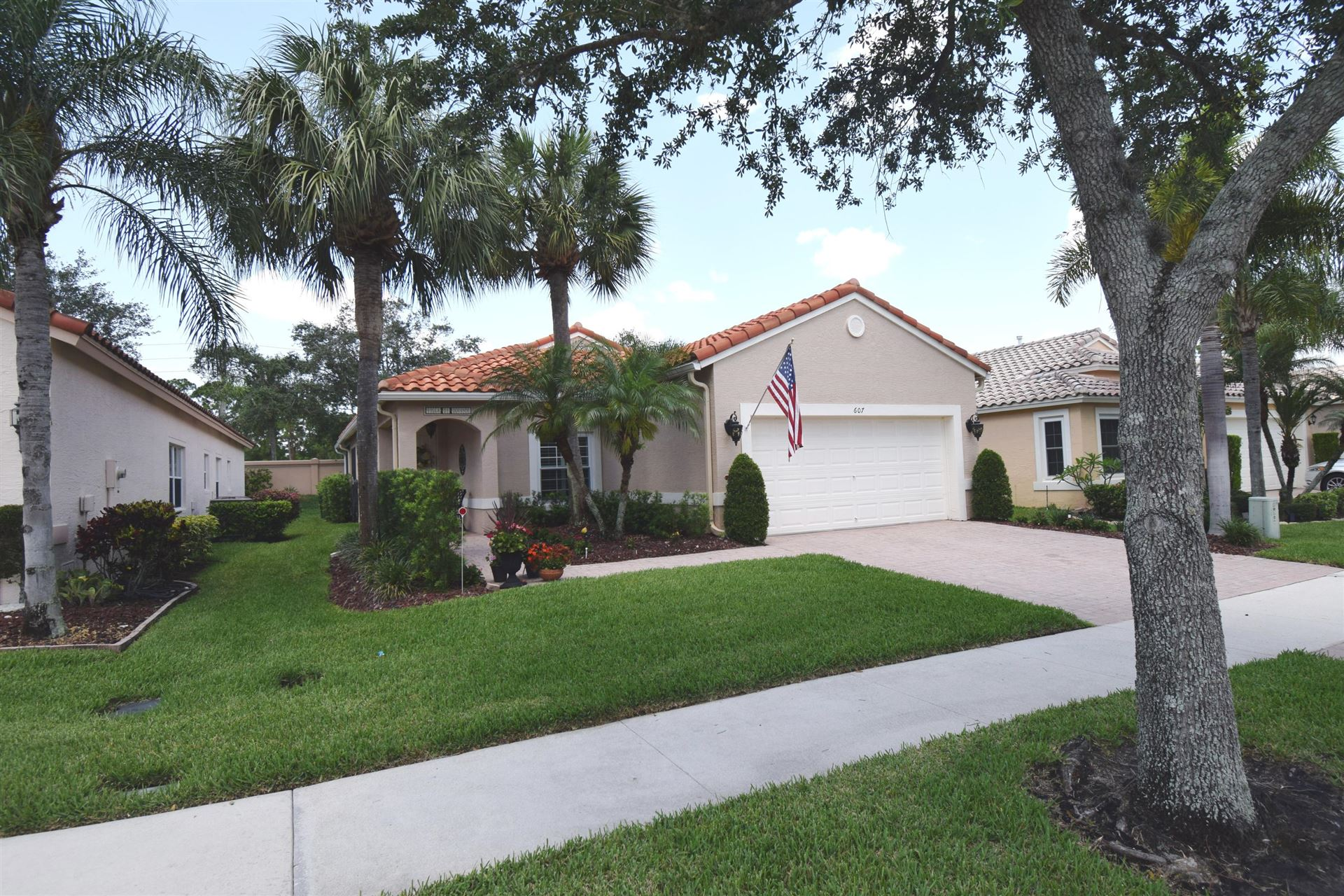 Photo of 607 NW Whitfield Way, Port Saint Lucie, FL 34986 (MLS # RX-10624705)