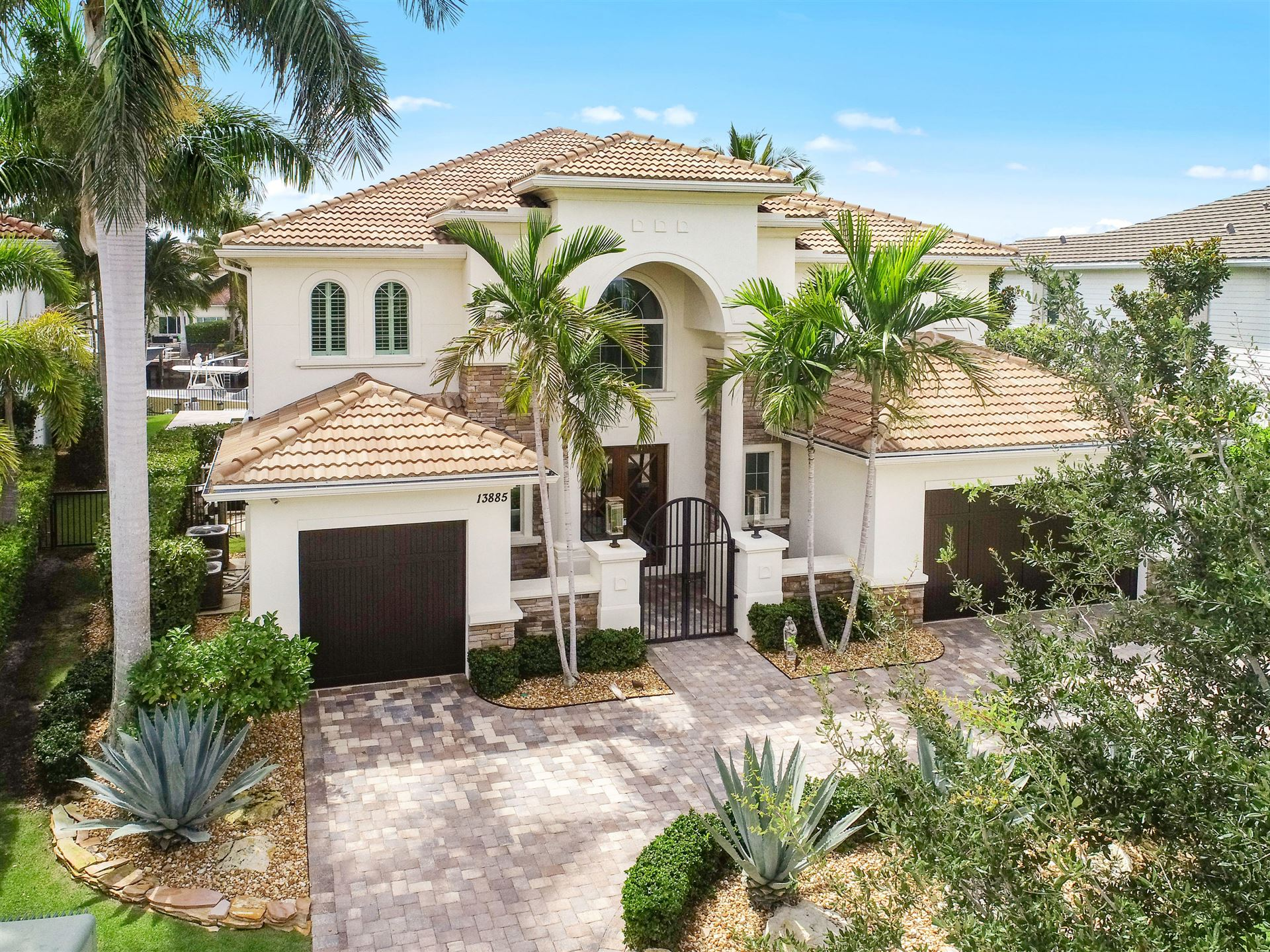 Photo of 13885 Willow Cay Drive, North Palm Beach, FL 33408 (MLS # RX-10655705)