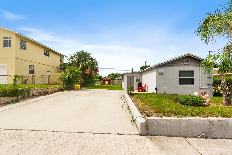 Photo of 1481 W 31st Street, Riviera Beach, FL 33404 (MLS # RX-10729708)