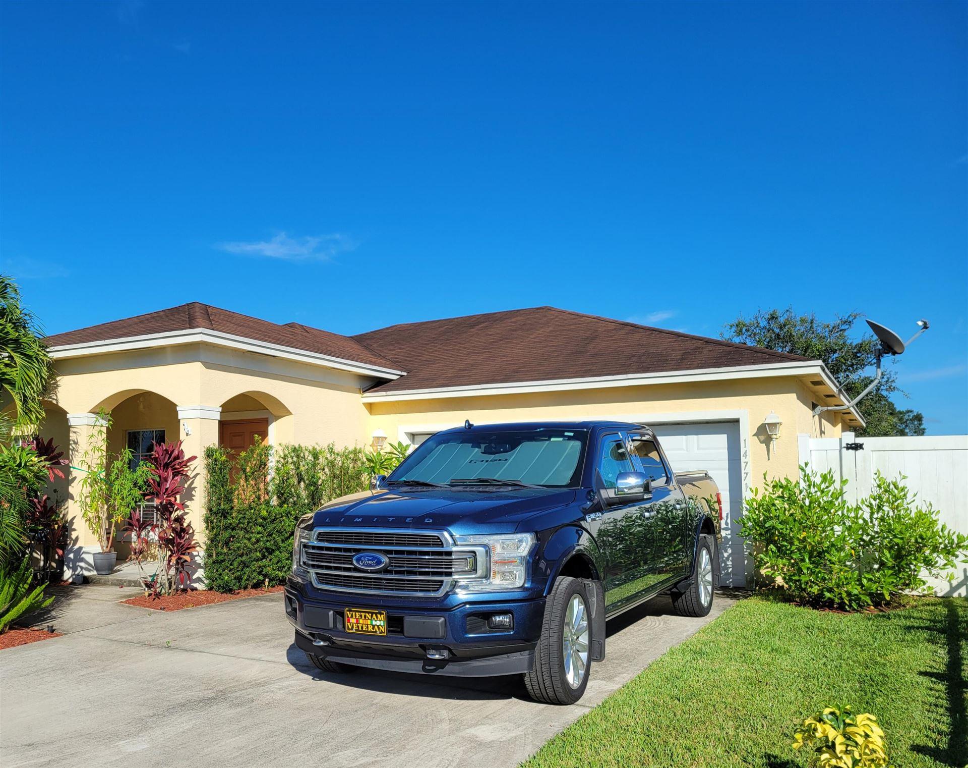 Photo of 14771 SW Sandy Oaks Loop, Indiantown, FL 34956 (MLS # RX-10739708)