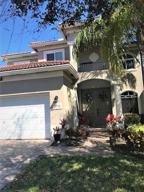 Photo of 1270 Rosegate Boulevard, Riviera Beach, FL 33404 (MLS # RX-10694710)
