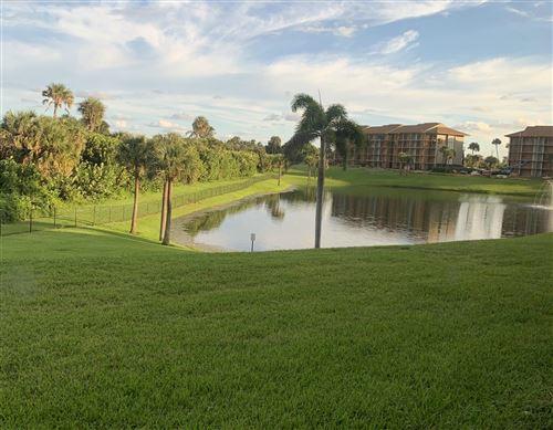 Photo of 101 S Seas Drive #101, Jupiter, FL 33477 (MLS # RX-10752717)